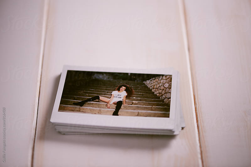 Heap of instant photos of Afro-American young woman by Guille Faingold for Stocksy United