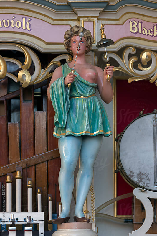 Animated figure on a street organ at a carnival by Paul Phillips for Stocksy United