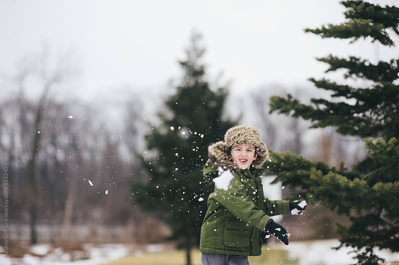 Snowball Fight by Melanie DeFazio for Stocksy United