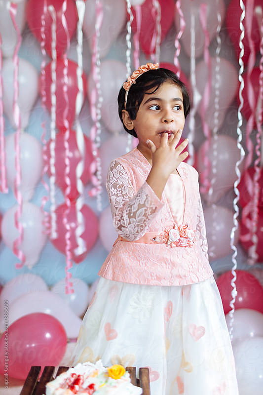 Cute little girl enjoying her birthday cake by Saptak Ganguly for Stocksy United