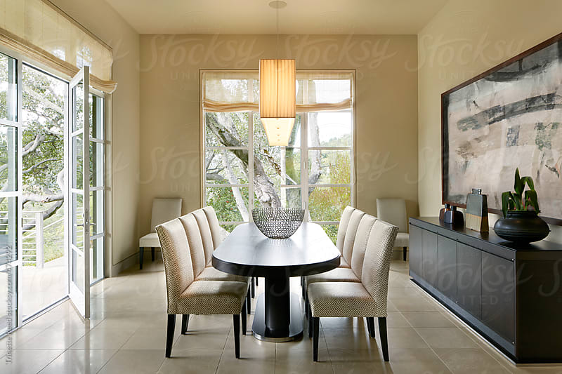 Dining room of luxury modern design home in California  by Trinette Reed for Stocksy United