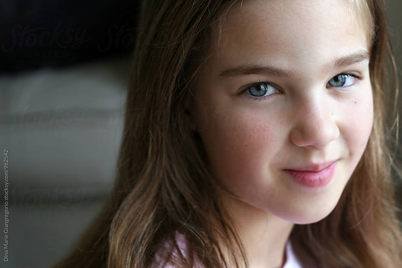 Pretty Pre-Teen Girl In Natural Light Smiling by Dina Giangregorio for Stocksy United