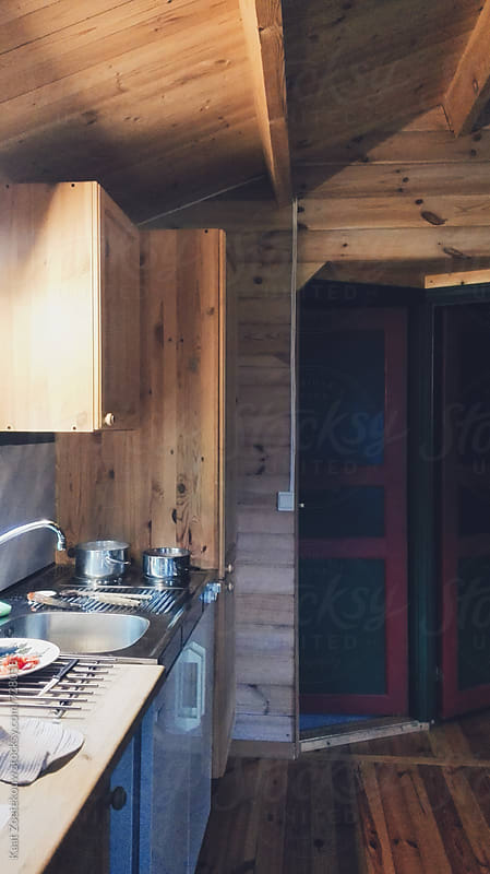 Wooden cabin's kitchenette  by Kaat Zoetekouw for Stocksy United