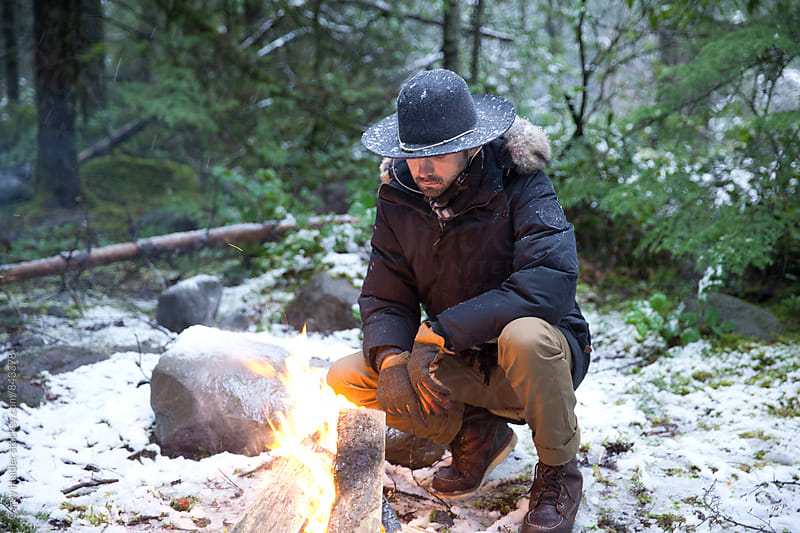 Man Next To Fire In Snow by Carey Haider for Stocksy United