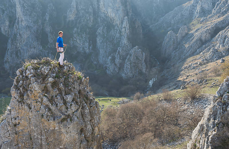 Climber looking at view  by RG&B Images for Stocksy United
