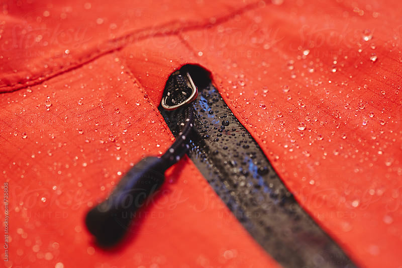 Waterproof zip and fabric of a hardshell mountaineering jacket. by Liam Grant for Stocksy United