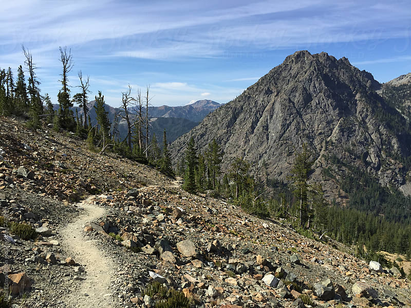 Hiking trail in the Central Cascades, mountains in distance by Paul Edmondson for Stocksy United