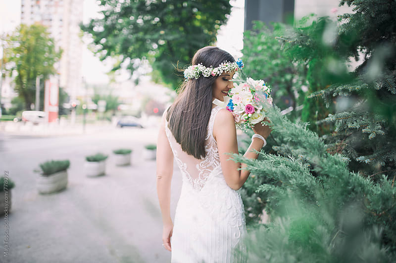 Beautiful bride outdoors by Maja Topcagic for Stocksy United