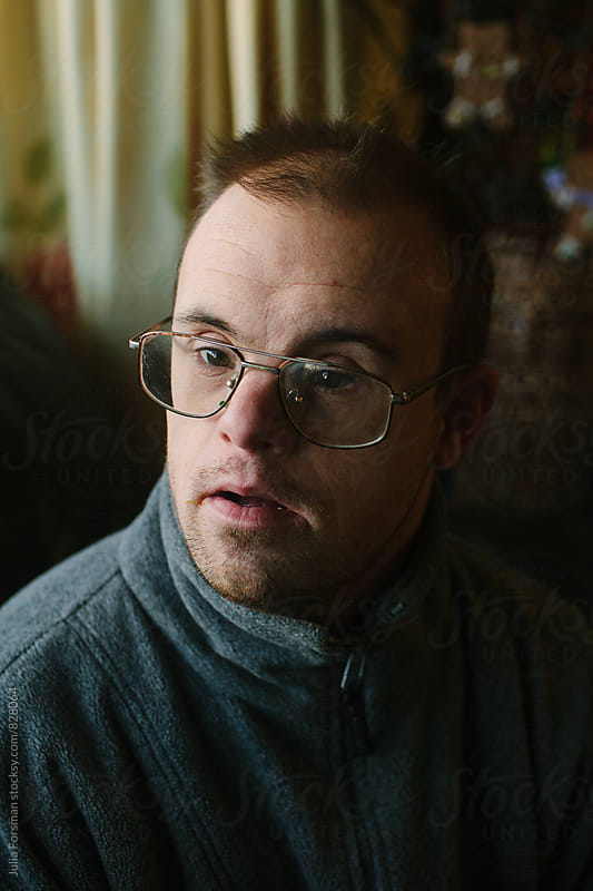 Close up portrait of a middle aged man with Down's syndrome. by Julia Forsman for Stocksy United