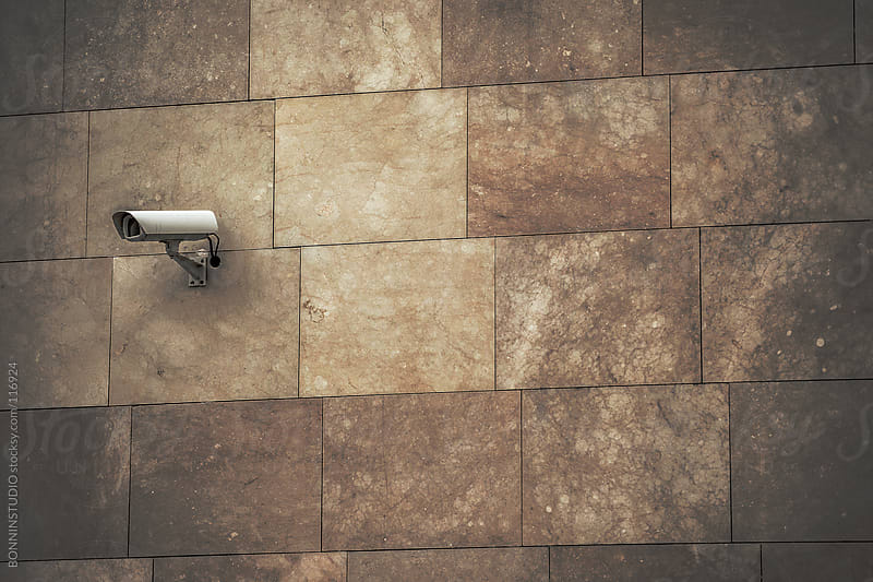 Security camera on wall. Lots of copy space. by BONNINSTUDIO for Stocksy United