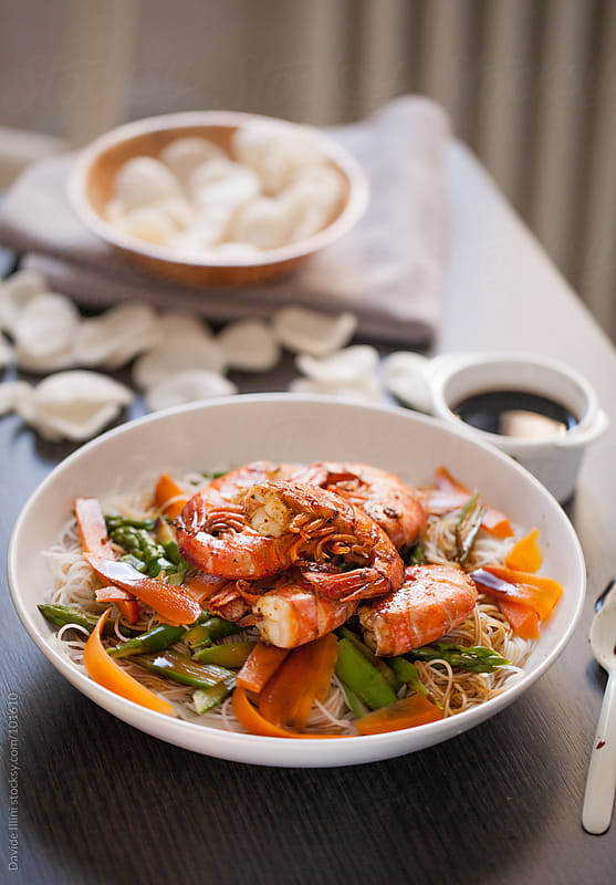 Rice noodles with prawns and mixed vegetables by Davide Illini for Stocksy United