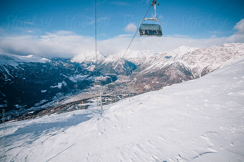 Chairlift in the Alps by Davide Illini for Stocksy United