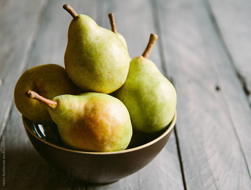 Pears in a bowl by Helen Rushbrook for Stocksy United