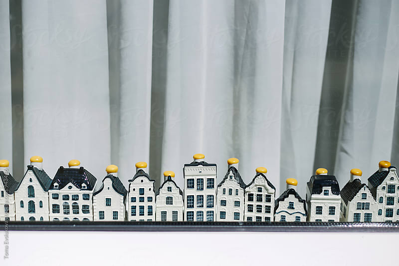 Little Amsterdam houses on the window by Toma Evsiukova for Stocksy United
