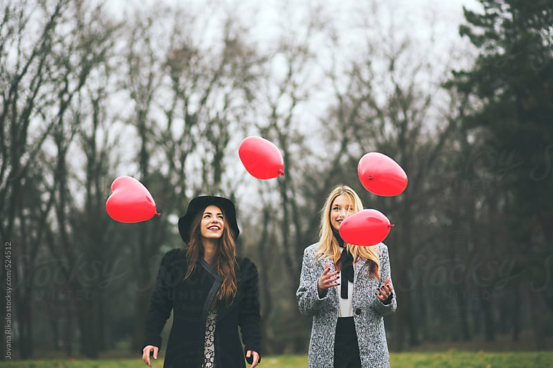 Female Friends Throwing Balloons In To Air Having Fun by Jovana Rikalo for Stocksy United
