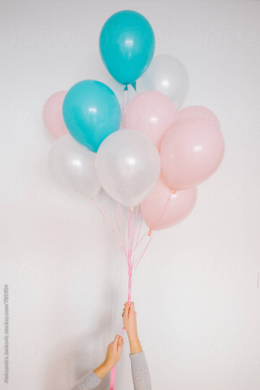 Woman Holding Balloons by Aleksandra Jankovic for Stocksy United