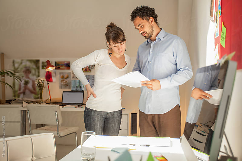 Colleagues Working in the Office by Mosuno for Stocksy United