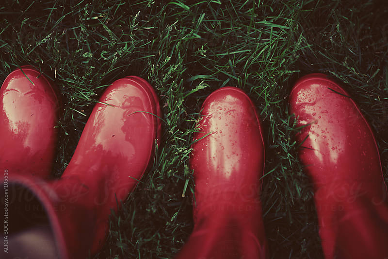 Two Pairs of Red Rainboots by ALICIA BOCK for Stocksy United