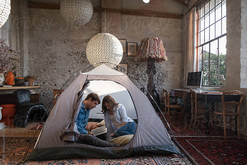 Couple Into Backpacking Tent into House by HEX. for Stocksy United