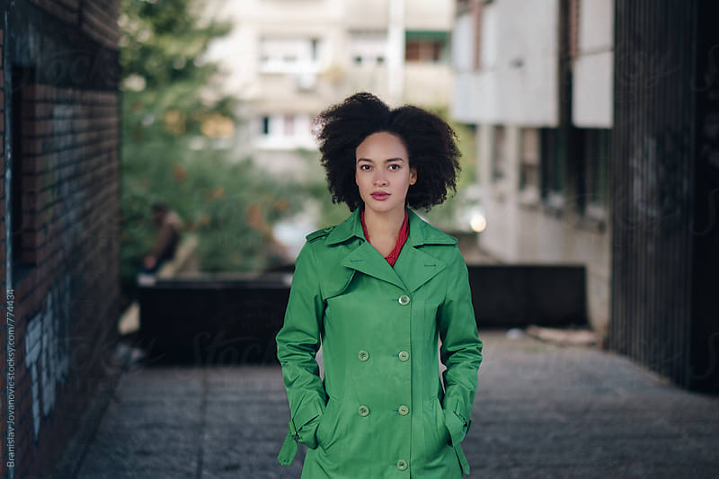 Portrait of a Beautiful Young Woman in Green Trench Coat by Branislav Jovanović for Stocksy United