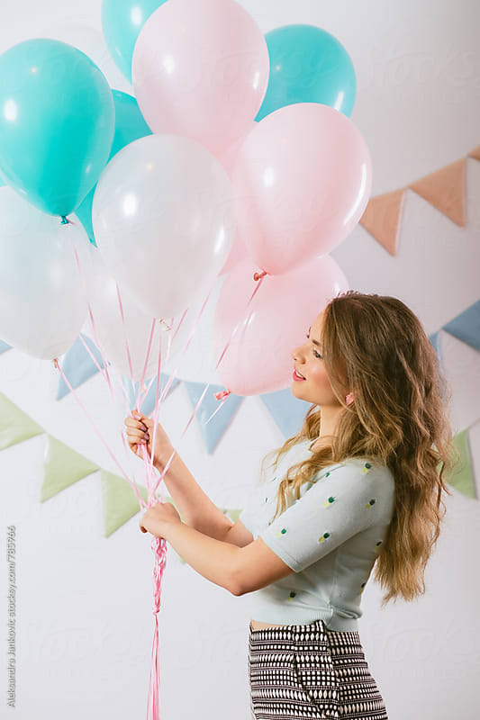Beautiful Young Woman Holding Balloons by Aleksandra Jankovic for Stocksy United