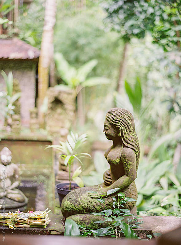 Balinese garden stone carving statue Ubud Bali  by Vicki Grafton Photography for Stocksy United
