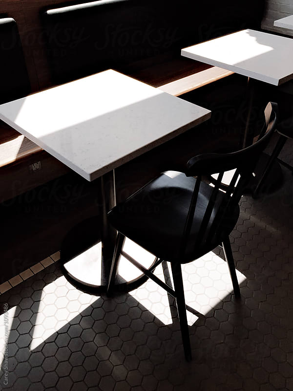 Light and shadow in modern coffee shop by Carey Shaw for Stocksy United