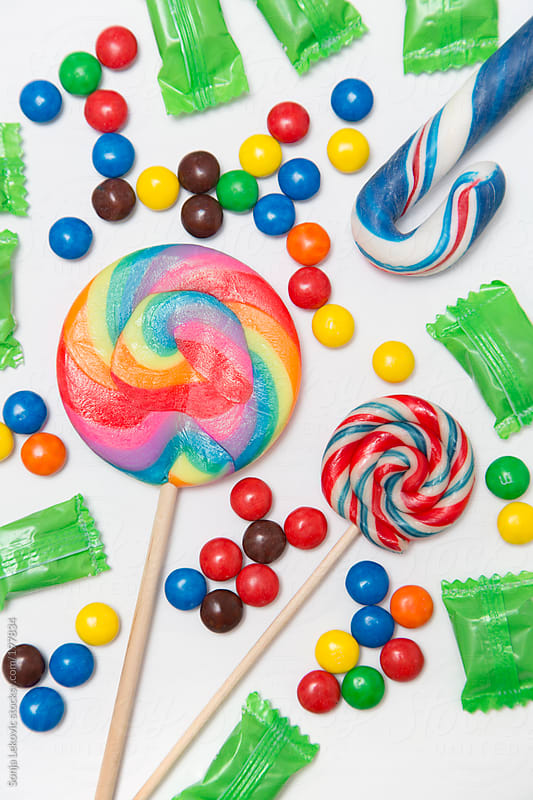 colorful candy on white background by Sonja Lekovic for Stocksy United