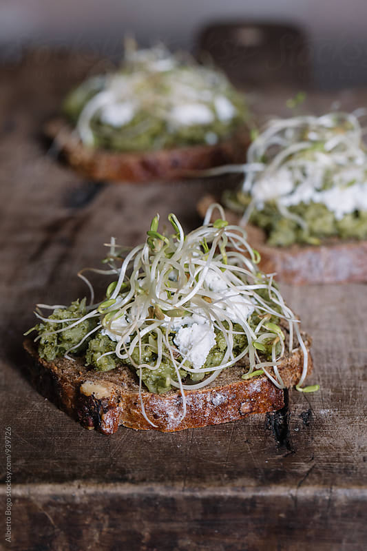 Close-up of delicious bruschetta on wooden table by Alberto Bogo for Stocksy United