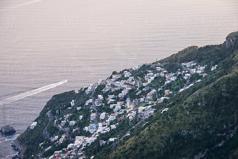 Small village on a steep hill by the ocean by Mike Marlowe for Stocksy United