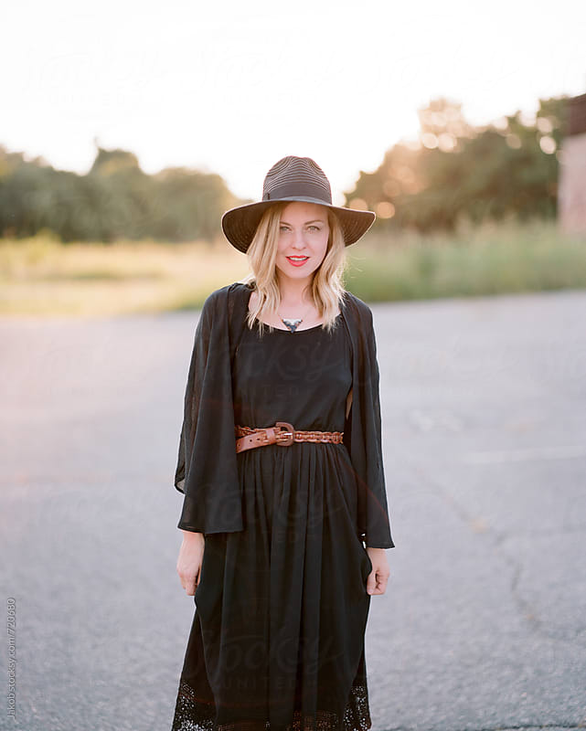 Beautiful and fashionable woman standing in an abandoned parking lot by Jakob for Stocksy United