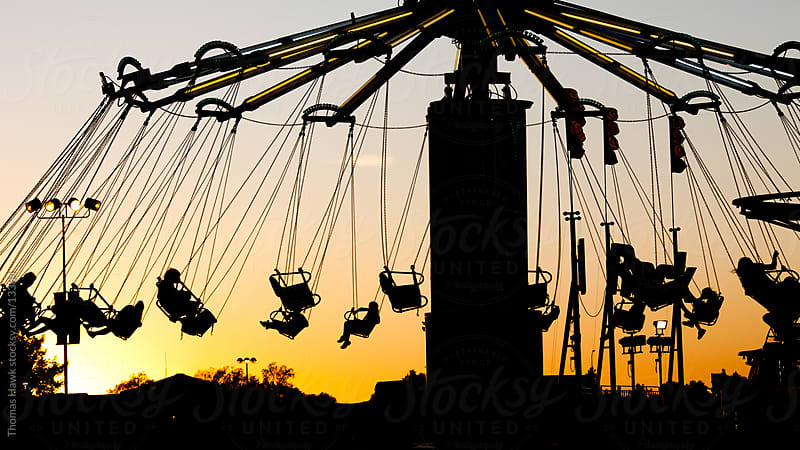 State Fair ride at sunset in silhouette by Thomas Hawk for Stocksy United