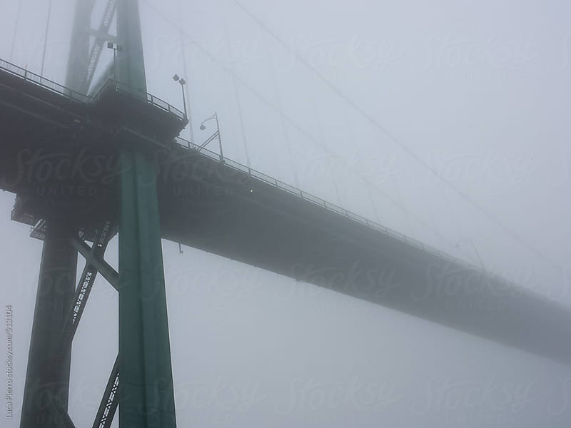 Lions Gate bridge in a foggy day, Vancouver, B.C. by Luca Pierro for Stocksy United