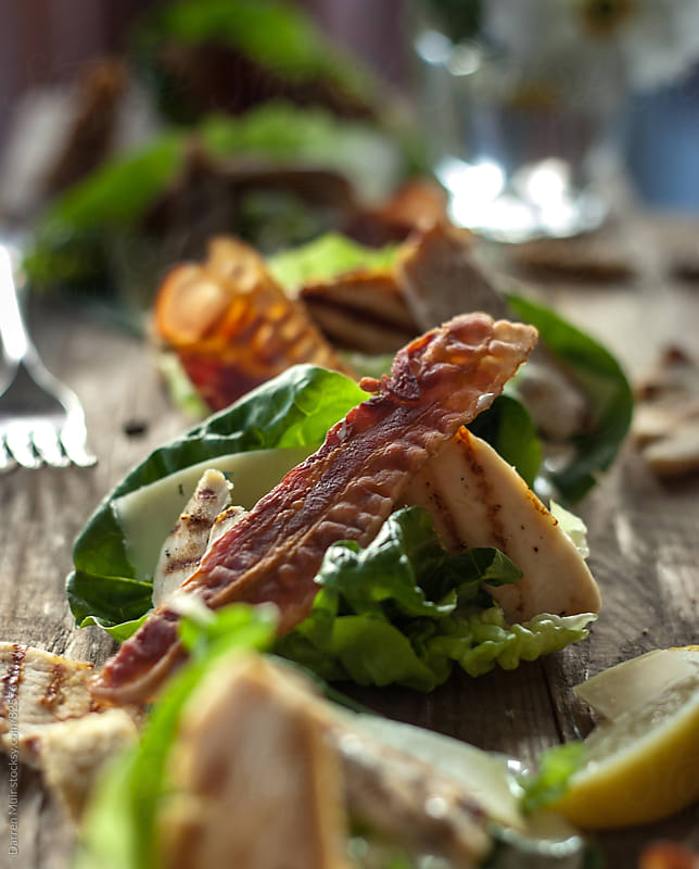 Chicken and bacon salad. by Darren Muir for Stocksy United