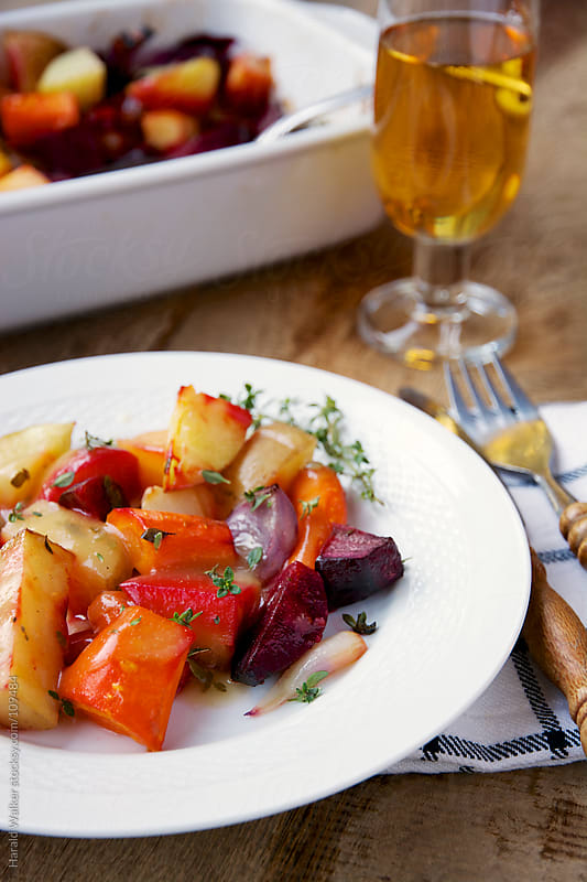 Oven roasted fall vegetables by Harald Walker for Stocksy United