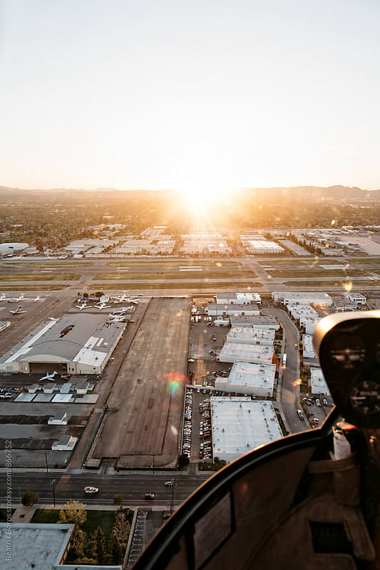 Small airport at sunset from above by Beatrix Boros for Stocksy United
