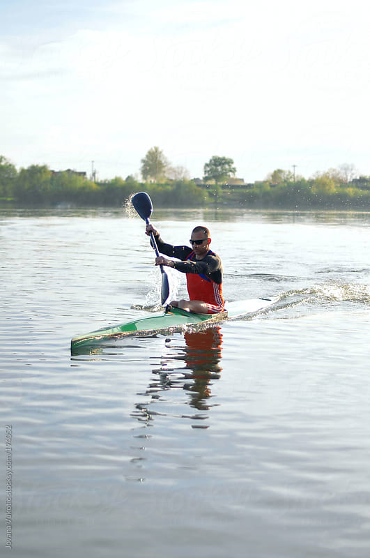 young man in kayak by Jovana Vukotic for Stocksy United