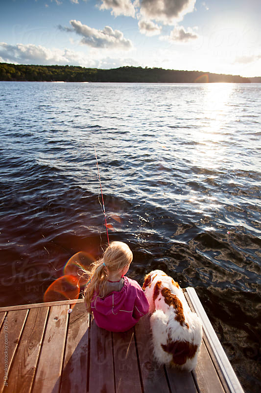 Little Girl Fishing From Dock at Cottage Lake With Dog by JP Danko for Stocksy United