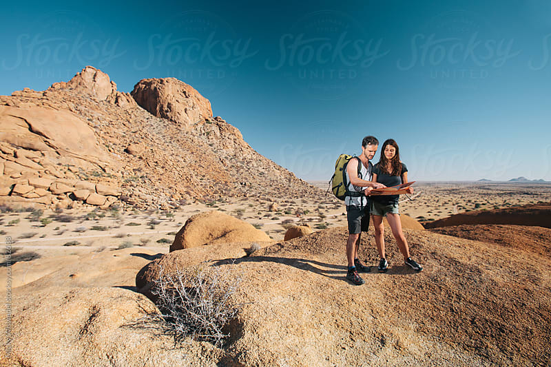 Attracitve healthy couple hiking in the mountains by Micky Wiswedel for Stocksy United