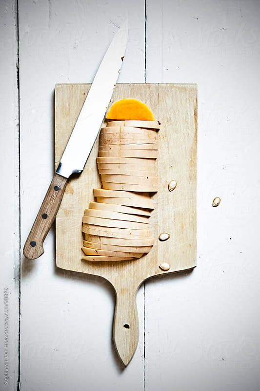 Sliced pumpkin by Sophia van den Hoek for Stocksy United