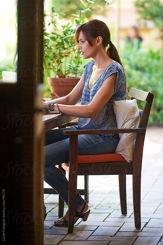 Young businesswoman working in the terrace of her house by Guille Faingold for Stocksy United