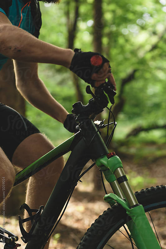 Close up of mountain biker riding by Aleksandar Novoselski for Stocksy United