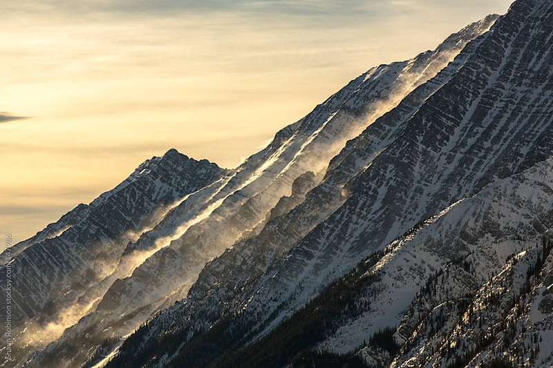 snow blowing off a mountain by Shaun Robinson for Stocksy United