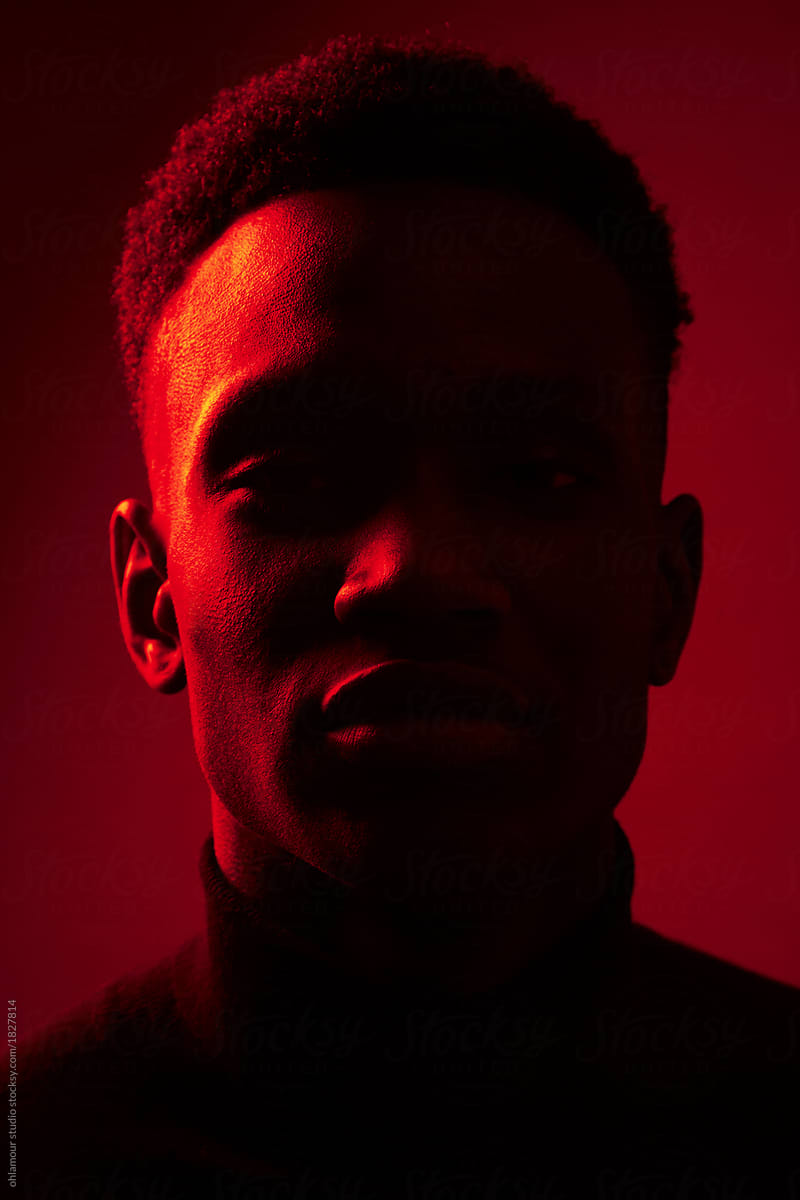 African American man portrait under red lights by ohlamour studio - Stocksy  United