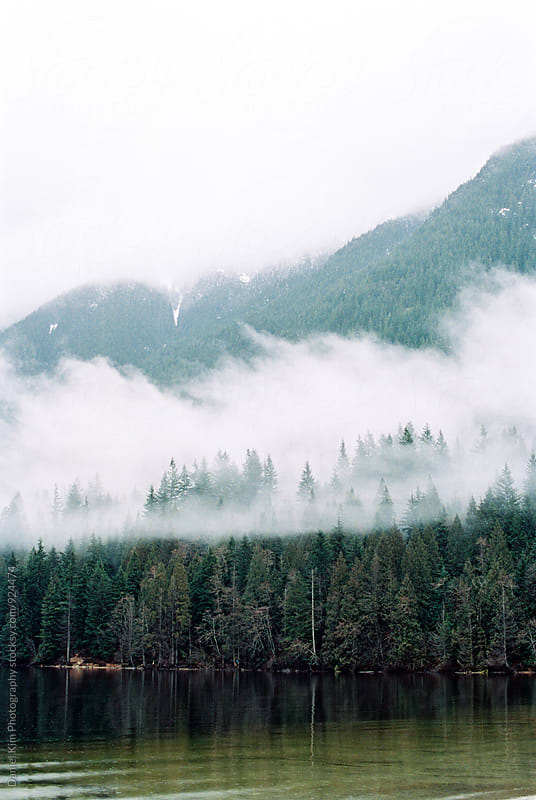 Foggy mountain lake scene by Daniel Kim Photography for Stocksy United