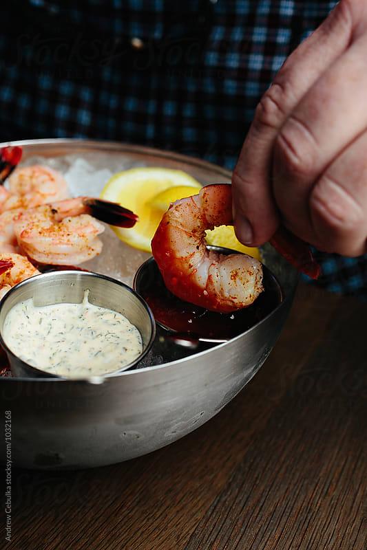 Shrimp Dipped in Sauce by Andrew Cebulka for Stocksy United