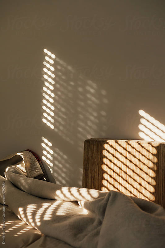 First sun. Sun shining through the window of the bedroom by Dimitrije Tanaskovic for Stocksy United