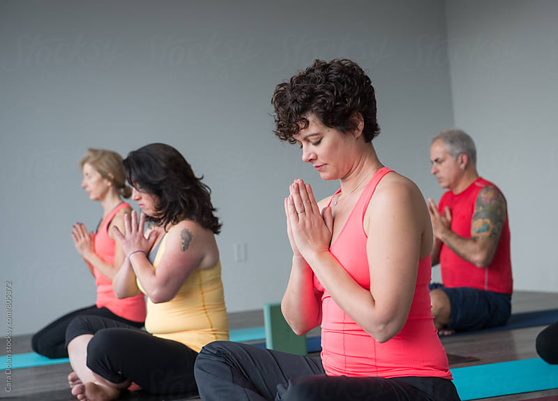 Yoga class in a modern studio by Cara Dolan for Stocksy United