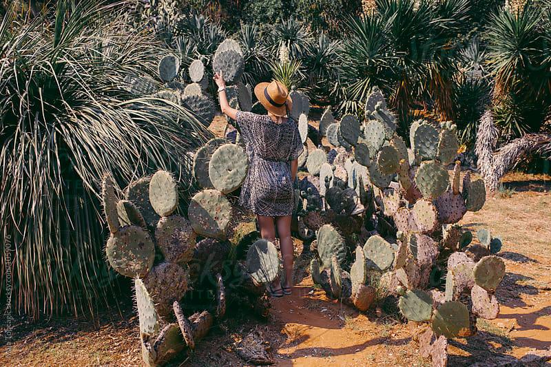 Woman in botanical garden by Maja Topcagic for Stocksy United