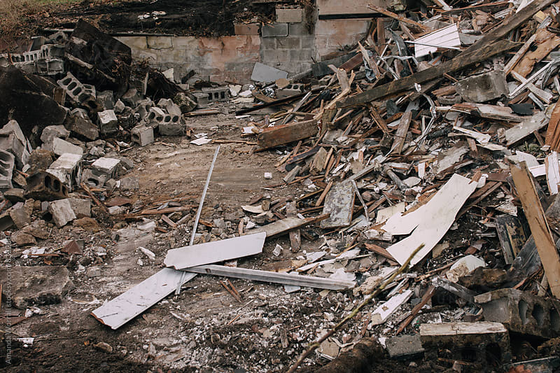 The basement of a house that is being torn down, demolition by Amanda Worrall for Stocksy United